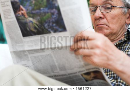 Man Read Newspapers