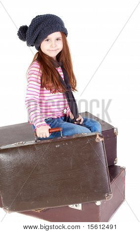 Cute Little Girl With Old Suitcases