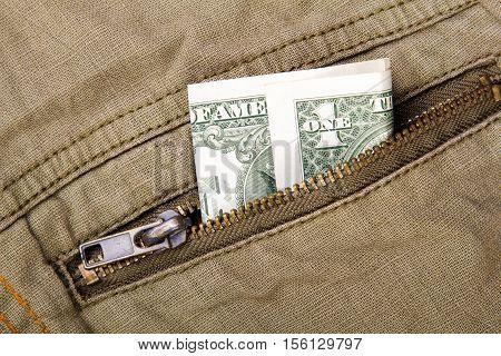 one dollar bill in a pocket, copy space