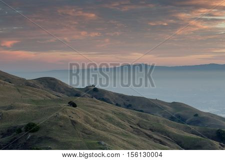 San Francisco East Bay Sunset, Looking South-West. South Bay and Santa Cruz Mountains Sunset from the Summit of Mission Peak, Fremont, California, USA.