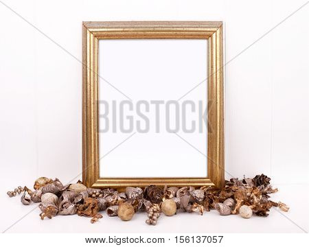 Christmas styled mockup portrait frame with gold potpourri in front of the frame