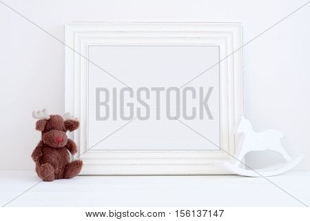 Christmas styled mockup portrait frame toy reindeer and rocking horse overlay your business message promotion headline or design great for lifestyle bloggers and social media campaigns