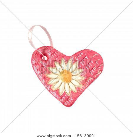 Homemade heart for Christmas decoration made child of salt dough isolated on white background. Children's art project children's handicraft. DIY concept
