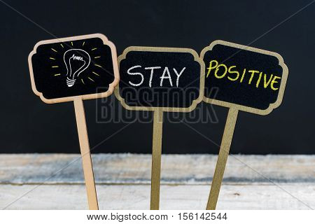 Concept Message Stay Positive And Light Bulb As Symbol For Idea