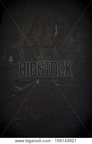 Rough textured black grunge concrete photo background
