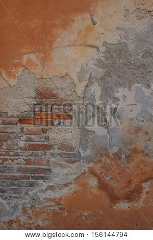 Rough textured plaster on brick photo background