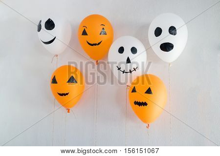 Halloween balloons decorated on white stock photo
