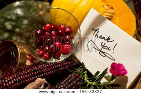 Thank you card with a Thanksgiving healthy food theme to thank clients in an autumn harvest abundant gift basket with candied cranberry home made compote indian corn and sweet pumpkin slice to send best wishes and geetings of the season to business client