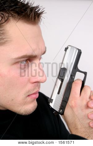 Man With Automatic Pistol