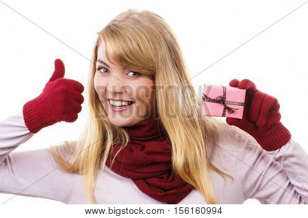 Woman Holding Wrapped Gift For Christmas And Showing Thumbs Up