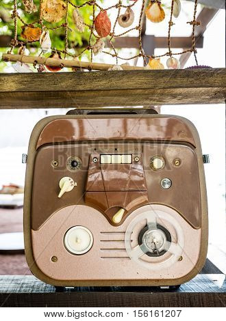 Retro portable turntable reel to reel tape recorder outdoors