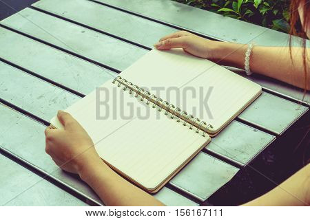 Human pick the blank note book vintage style