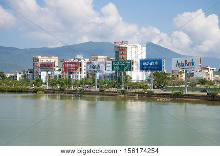DANANG, VIETNAM - JANUARY 06, 2016: View of the embankment of the Han river on a sunny day.  The tourist landmark of the city Da Nang