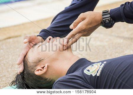 HEAD TILT CHIN LIFT CPR COURSE BANGKOK NOVEMBER 8 2016: cpr victim drowning training course at BANGKOK THAILAND NOVEMBER 8 2016