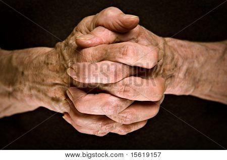 Senior hands praying