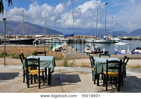 Greek terrace in harbor at Ionian island