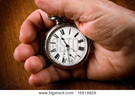 Pocket watch in senior man's hand