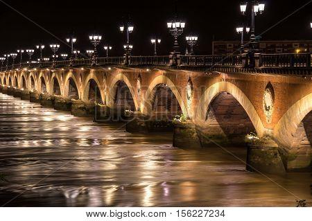 Pont de Pierre in Bordeaux in the night Aquitaine France