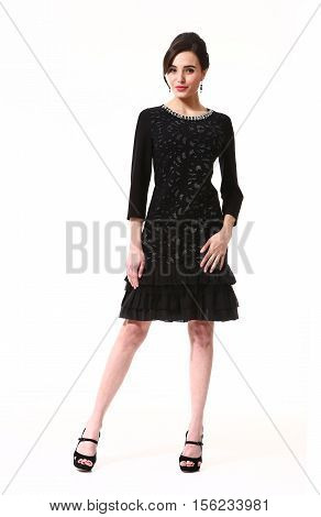 woman with updo hair style in fokrmal party black dress high heels shoes full length body portrait standing isolated on white