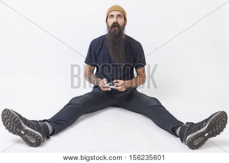 Hipster With A Game Controller On The Floor
