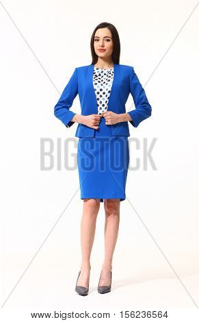woman with straight hair style in blue official suit skirt and jacket high heels shoes full length body portrait standing isolated on white