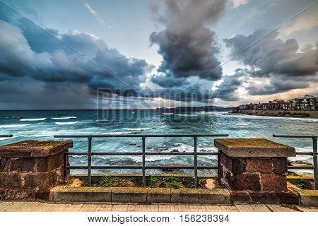 metal railing by the shore in Alghero Sardinia