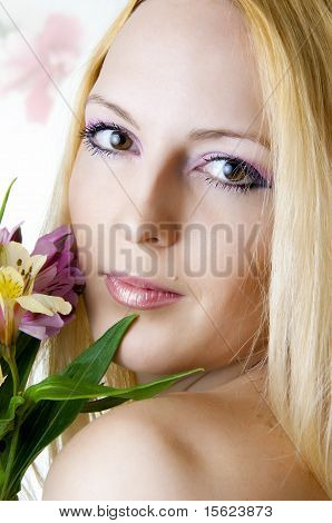 Female Face With Healthy Skin And Flowers.