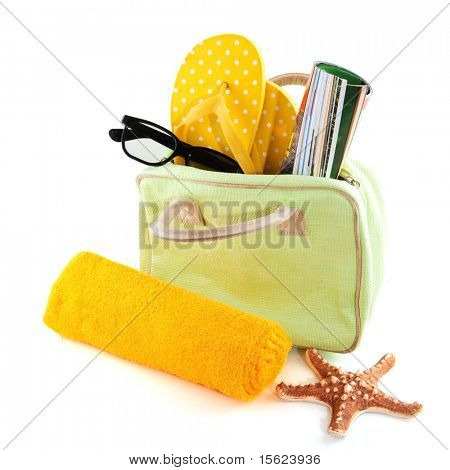 leisure at the beach with sunglasses and towel