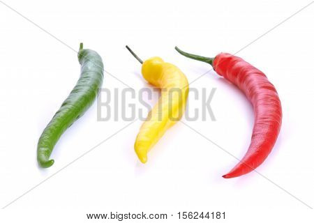 red and yellow chili pepers over white background