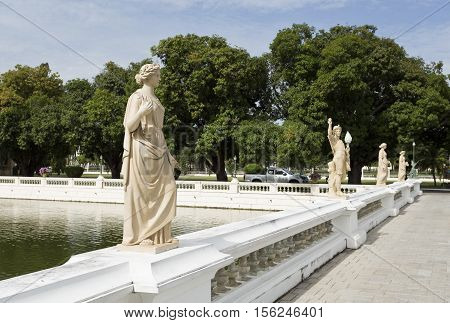 AYUTTHAYA, THAILAND - November 4, 2016: View of the bridge with standing neoclassical statues on each balustrade at the Bang Pa-in Palace compound Thailand.