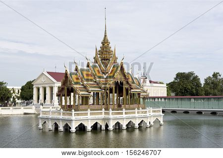 AYUTTHAYA, THAILAND - November 4, 2016: View of the Phra Thinang Aisawan Thiphya-art a pavilion with four porches and a spired roof at the Bang Pa-in Palace compound Thailand.