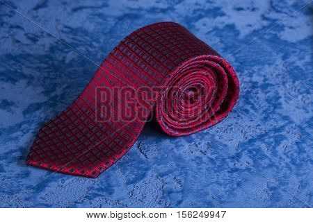Red tie and cufflinks on a blue marble background for the holiday Father's Day