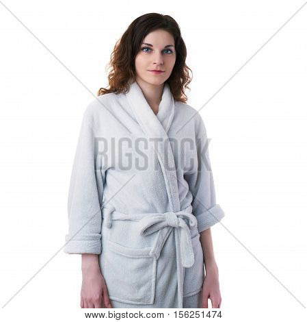 Smiling young woman in bath robe over white isolated background morning, healthy, relaxation and beauty concept