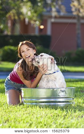Beautiful Woman Washing Her Pet Dog In A Tub