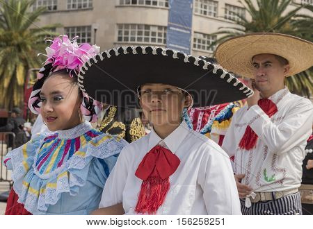 Mexico, Mexico City- 12 November 2016: start of festivities for the commemoration of the Mexican Revolution in front of the Monument of the Revolution in Mexico City, couple of guys