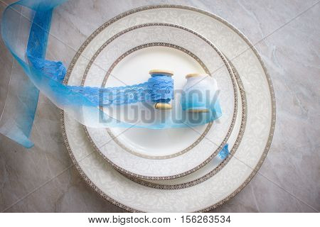 bobbins with ribbon are on the plate