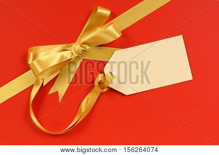 Red And Gold Christmas Gift Ribbon Bow With Blank Tag Or Label Diagonal