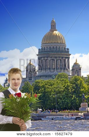The pupil in a school uniform with a bunch of flowers in the center of Petersburg Russia.