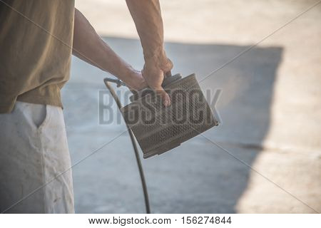 Blowing car air filter,Man blowing car air filter in business carcare