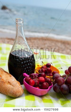Wine fruit and bread at the beach