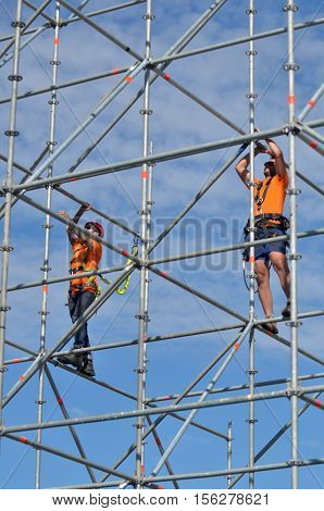 SYDNEY - OCT 19 2016:Scaffold builders at work.OSHA statistics report that about 28% of the scaffold accidents that occur are the result of construction deficiencies.