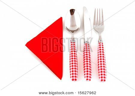 Colorful checkered cutlery and red napkin isolated over white