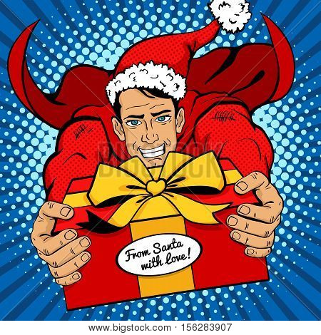 Pop Art Christmas Man. Young Handsome Man In Red Superhero Costume And Santa Clause Hat Flies With B