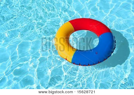 swimming pool with floatable toys in the water