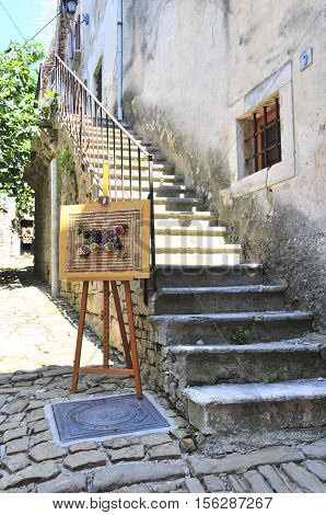 Artwork In Front Of Stairs To Artist's Shop