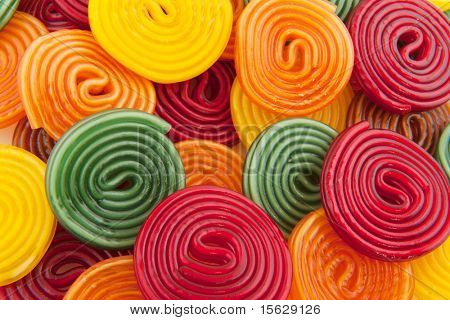 colorful licorice candy drop rolls as background