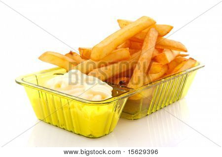Portion French fries with mayonaise isolated over white