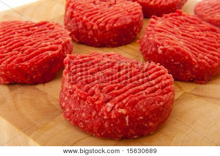 Raw tartar steak meat on wooden timber