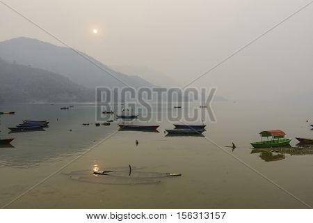 Phewa Lake by a hazy day in Pokhara, Nepal