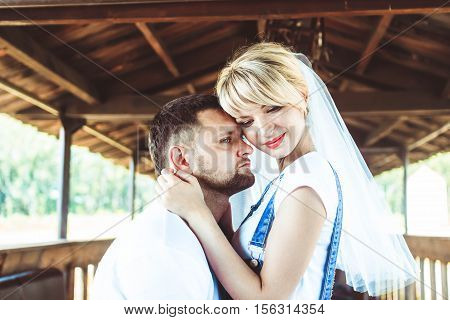 Bride and groom at wedding Day walking Outdoors on spring nature. Bridal couple, Couple in love bride and groom posing near wooden bench in gazebo in their wedding day
